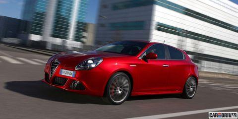 Mode of transport, Automotive design, Vehicle, Alfa romeo mito, Car, Red, Automotive mirror, Fender, Alloy wheel, Grille,