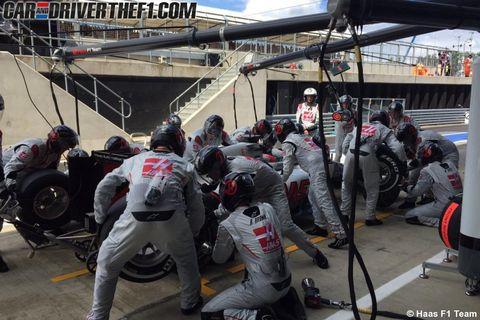Helmet, Automotive tire, Team, Crew, Sports gear, Motorcycle, Pit stop, Race track,