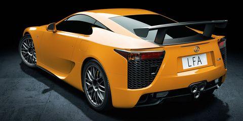 Motor vehicle, Mode of transport, Automotive design, Vehicle, Yellow, Land vehicle, Event, Car, Automotive lighting, Supercar,