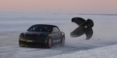 Automotive design, Winter, Car, Performance car, Logo, Automotive lighting, Automotive tire, Hood, Luxury vehicle, Freezing,
