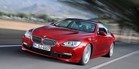 Tire, Mode of transport, Automotive design, Vehicle, Land vehicle, Grille, Car, Automotive lighting, Red, Rim,