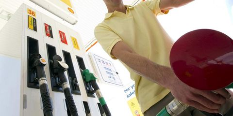 Elbow, Gas pump, Cable, Wrist, Electricity, Filling station, Machine, Gasoline, Electrical wiring, Electrical supply,