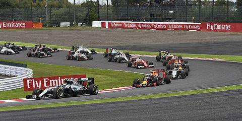 Tire, Wheel, Automotive tire, Automotive design, Vehicle, Open-wheel car, Land vehicle, Race track, Motorsport, Sport venue,