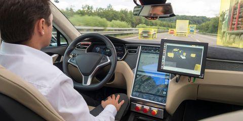 Vehicle, Car, Motor vehicle, Luxury vehicle, Driving, Tesla model s, Steering wheel, Electronics, Center console, Automotive design,