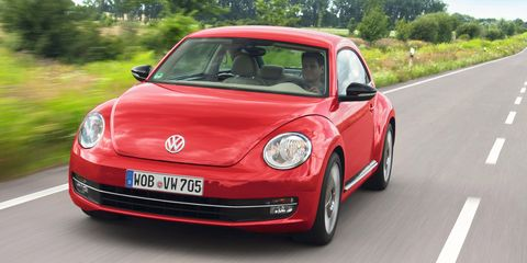 Motor vehicle, Automotive design, Automotive mirror, Vehicle, Transport, Land vehicle, Car, Road, Red, Rim,
