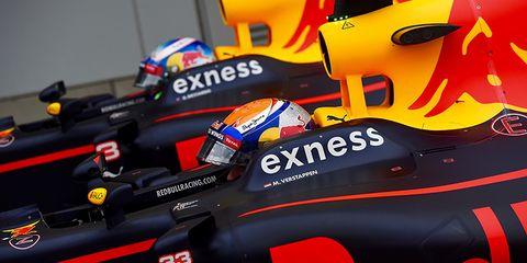 Yellow, Automotive design, Red, Orange, Logo, Personal protective equipment, Racing, Motorsport, Race car, Automotive decal,
