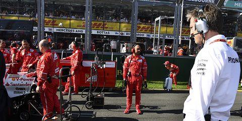 Red, Pit stop, Race track, Sport venue, Formula one, Vehicle, Car, Event, Race car, Motorsport,