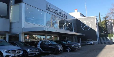 Vehicle, Car, Luxury vehicle, Transport, Building, Car dealership, Facade, Architecture, Mid-size car, Commercial building,