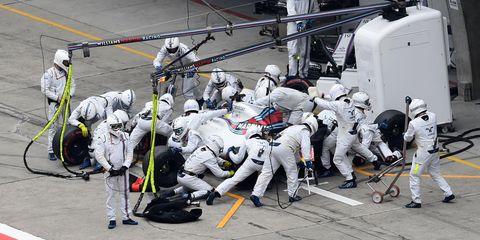 Team, Crew, Helmet, Machine, Navy, Safety glove, Government agency,