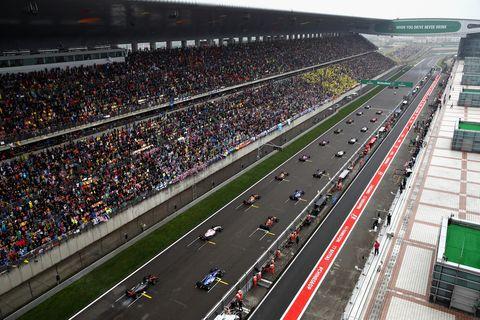 Sport venue, Race track, Metropolitan area, Urban area, Crowd, Stadium, Auto racing, Thoroughfare, Motorsport, Racing,