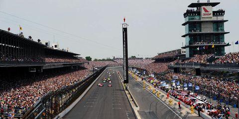 Race track, Sport venue, Urban area, Architecture, City, Metropolitan area, Sky, Tower, Thoroughfare, Stadium,