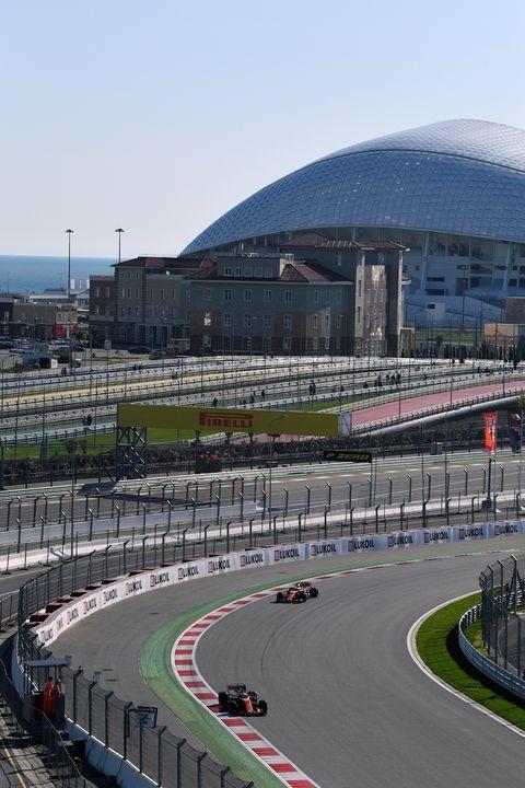 Sport venue, Race track, Automotive tire, Road surface, Asphalt, Racing, Motorsport, Auto racing, Sports car racing, Race car,