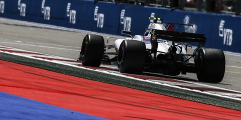 Tire, Wheel, Automotive tire, Automotive design, Open-wheel car, Formula one tyres, Automotive wheel system, Sport venue, Formula one car, Formula one,