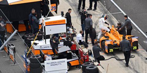 Motor vehicle, Race track, Sport venue, Vehicle, Race car, Formula one car, Car, Automotive design, Asphalt, Technology,