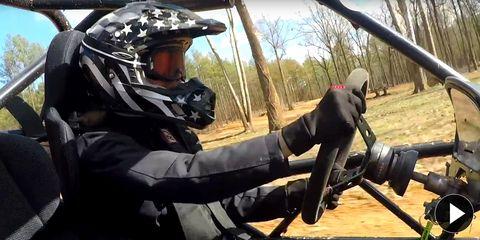 Helmet, Motorcycle helmet, Personal protective equipment, Sports gear, Glove, Motorcycling, Military person, Motorcycle racer, Motorcycle accessories, Machine gun,