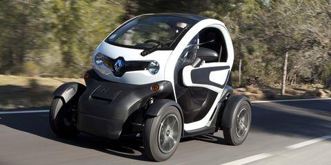 Motor vehicle, Mode of transport, Automotive design, Automotive tire, Automotive mirror, Road surface, Automotive wheel system, Asphalt, Fender, Rim,