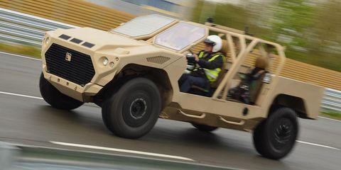 Land vehicle, Vehicle, Car, Military vehicle, Armored car, Armored car, Sport utility vehicle, Snatch land rover, Humvee, Wheel,