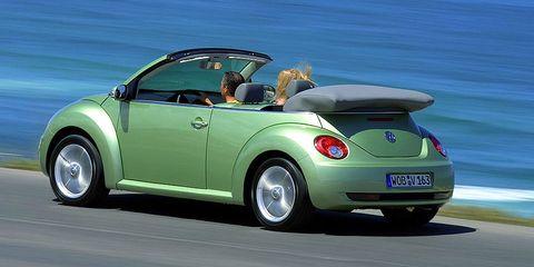 Motor vehicle, Mode of transport, Automotive design, Blue, Vehicle, Automotive exterior, Land vehicle, Vehicle door, Car, Glass,
