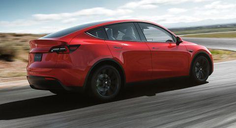 Land vehicle, Vehicle, Car, Automotive design, Tesla, Rim, Tesla model s, Automotive tire, Mid-size car, Tire,