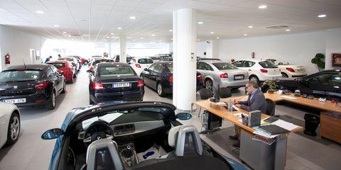Automotive design, Land vehicle, Vehicle, Car, Table, Automotive parking light, Personal luxury car, Luxury vehicle, Retail, Parking,
