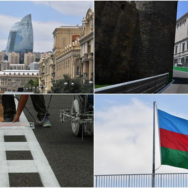 Architecture, Flag, Photograph, Facade, Urban area, City, Building, Metropolitan area, Town, Landmark,