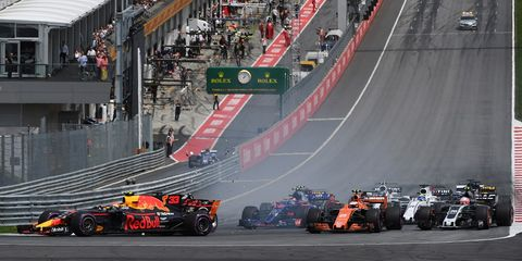 Automotive design, Sport venue, Race track, Automotive tire, Formula one, Racing, Motorsport, Logo, Asphalt, Open-wheel car,
