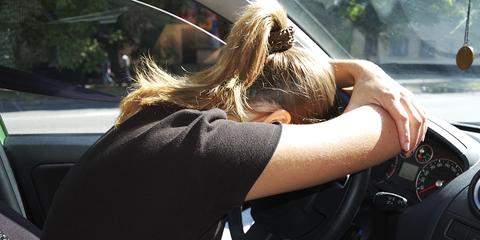 Hairstyle, Glass, Steering part, Steering wheel, Windshield, Automotive mirror, Blond, Automotive window part, Long hair, Vehicle door,