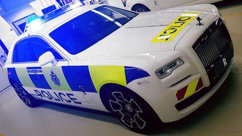 Land vehicle, Vehicle, Car, Police car, Luxury vehicle, Police, Law enforcement, Automotive design, Rolls-royce, Sedan,