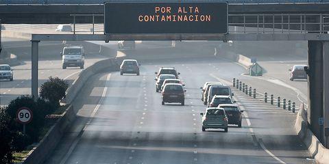 Motor vehicle, Road, Mode of transport, Highway, Lane, Automotive parking light, Infrastructure, Road surface, Automotive mirror, Automotive design,