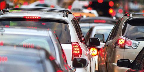 Motor vehicle, Vehicle, Car, Traffic, Traffic congestion, Mode of transport, Automotive tail & brake light, Road, Automotive exterior, Event,