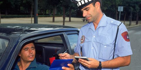 Motor vehicle, Vehicle, Car, Official, Automotive window part, Police officer, Family car, Cap,