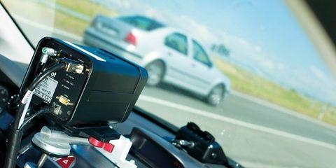 Motor vehicle, Automotive mirror, Mode of transport, Automotive design, Road, Automotive exterior, Glass, Road surface, Vehicle door, Asphalt,
