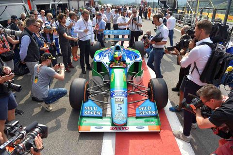 Race track, Motor vehicle, Race car, Formula racing, Pit stop, Vehicle, Sport venue, Formula one tyres, Open-wheel car, Formula one,