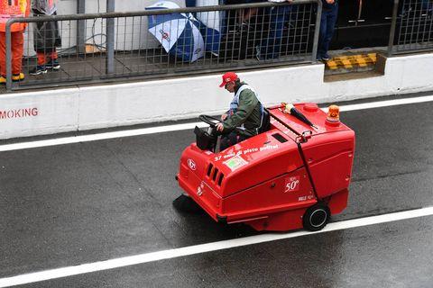 Vehicle, Red, Mode of transport, Asphalt, Automotive wheel system, Car, Wheel, Street sweeper, Road, Road surface,