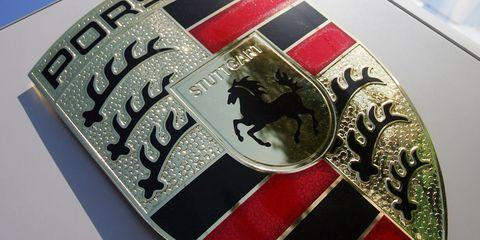 Emblem, Fashion accessory, Symbol, Logo, Car, Porsche, Crest,