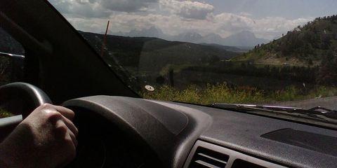 Motor vehicle, Automotive design, Glass, Mountainous landforms, Highland, Windscreen wiper, Hill, Automotive exterior, T-shirt, Mountain range,