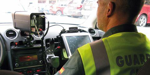 Motor vehicle, Electronics, Vehicle, Transport, Mode of transport, Technology, Job, Driving, Car, Electronic device,