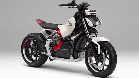 Land vehicle, Vehicle, Motorcycle, Car, Automotive exhaust, Automotive design, Honda, Exhaust system, Rim, Spoke,