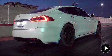 Land vehicle, Vehicle, Car, Motor vehicle, Tesla model s, Luxury vehicle, Tesla, Rim, Performance car, Automotive design,