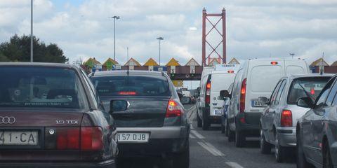 Motor vehicle, Automotive tail & brake light, Mode of transport, Vehicle, Land vehicle, Automotive exterior, Vehicle registration plate, Automotive parking light, Car, Transport,