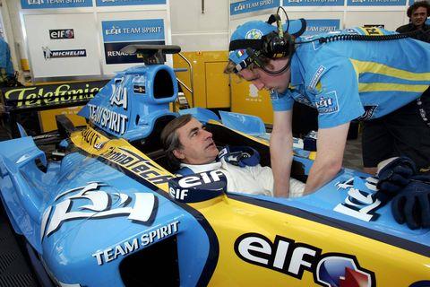 Race car, Sports, Vehicle, Yellow, Car, Formula one car, Formula racing, Team, Open-wheel car, Sports car,
