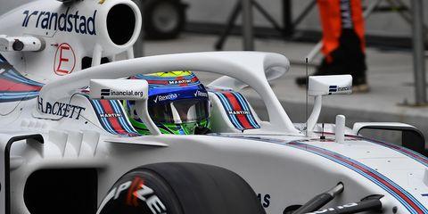 Formula racing, Vehicle, Race car, Helmet, Car, Formula one, Sports car racing, Formula one car, Personal protective equipment, Automotive design,