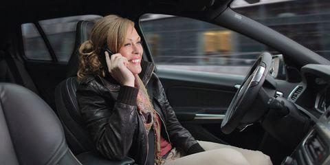 Vehicle door, Vehicle, Car, Automotive design, Leather, Blond, Jacket, Family car, Driving, Mid-size car,