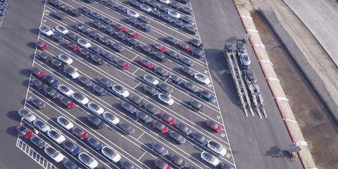 Motor vehicle, Transport, Parking lot, Traffic, Thoroughfare, Metal, Infrastructure, Road, Vehicle, Steel,