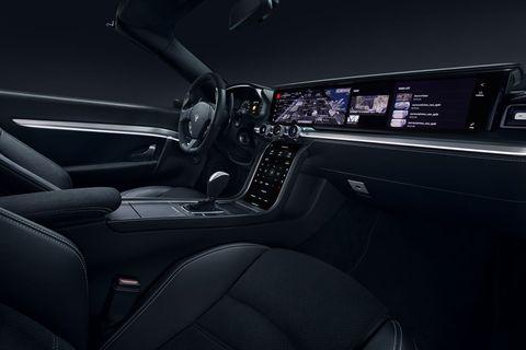 Vehicle, Car, Luxury vehicle, Center console, Gear shift, Automotive design, Personal luxury car, Steering wheel, Sedan,