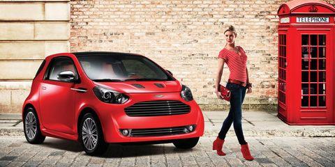 Tire, Motor vehicle, Wheel, Automotive design, Vehicle, Brick, Land vehicle, Red, Vehicle door, Grille,
