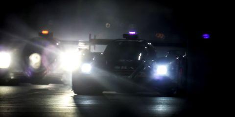 Headlamp, Automotive lighting, Light, Mode of transport, Vehicle, Police car, Darkness, Lighting, Police, Car,