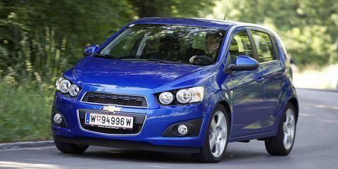 Tire, Motor vehicle, Wheel, Mode of transport, Automotive design, Blue, Automotive mirror, Daytime, Vehicle, Transport,