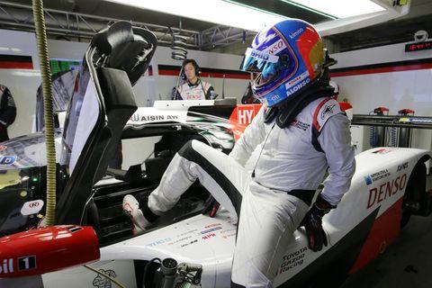 Formula racing, Helmet, Race track, Vehicle, Sport venue, Motorsport, Personal protective equipment, Formula one, Car, Auto racing,