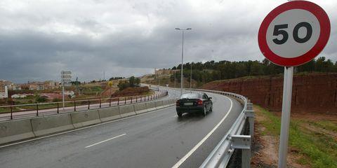 Motor vehicle, Road, Road surface, Asphalt, Infrastructure, Highway, Guard rail, Lane, Automotive lighting, Freeway,